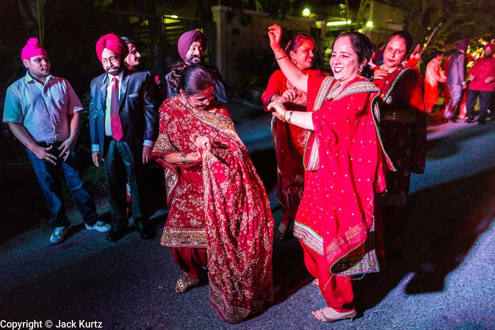 09 JANUARY 2014 - BANGKOK, THAILAND:  A Sikh wedding procession on Ekkamai Soi 6 in Bangkok. Bangkok has a vibrant and growing Sikh community and Sikhs are very active in the Thai business community.       PHOTO BY JACK KURTZ