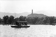 C009-23_Tom Hutchins_Small covered boat on Kunming lake, pagoda in distant, Peking, China 1956 A2.tif