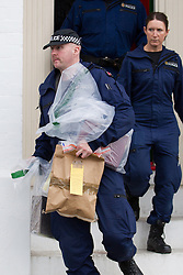 © Licensed to London News Pictures . 09/10/2012 . Altrincham , UK . Police remove property from the house on 1 Woodlands Road , Altrincham , Cheshire today (9th October 2012) where they continue to search the premises . Police arrested Jimmy Savile's former chauffeur , Ray Teret , and housemate Alan Ledger , yesterday (8th November) over historic child rape allegations . Photo credit : Joel Goodman/LNP