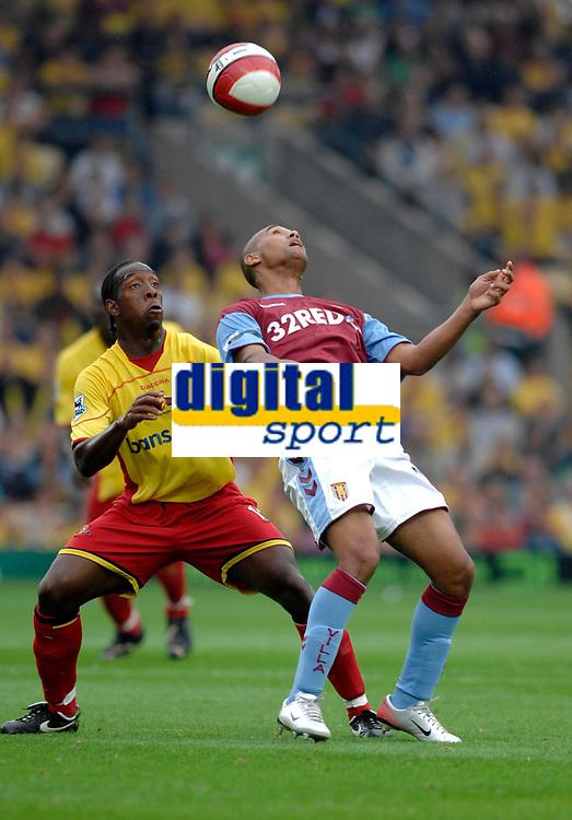 Photo: Richard Lane.<br />Watford v Aston Villa. The Barclays Premiership. 16/09/2006. <br />Villa's Luke Moore is chellenged by Lloyd Doyley.
