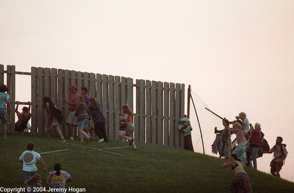 Deadheads crash the gates at Deer Creek music center in on July 2, 1995, which led to the next day's show being canceled. (Photo by Jeremy Hogan) © 1995
