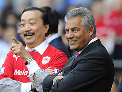 Cardiff City owner, Tan Sri Vincent Tan (left) shares a joke with Cardiff City Chairman, Mehmet Dalman  - Photo mandatory by-line: Joe Meredith/JMP - Tel: Mobile: 07966 386802 25/08/2013 - SPORT - FOOTBALL - Cardiff City Stadium - Cardiff -  Cardiff City V Manchester City - Barclays Premier League
