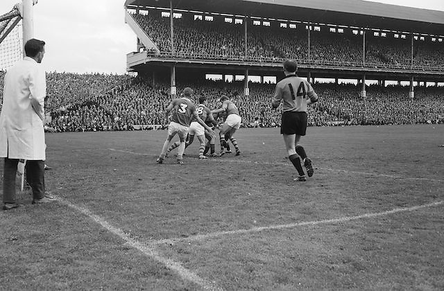 Down's forward P. Doherty is tackled by four Kerry backs during the All Ireland Senior Gaelic Football Final Kerry v Down in Croke Park on the 22nd September 1968. Down 2-12 Kerry 1-13.