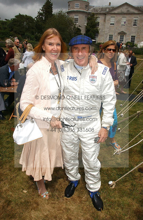 """SIR JACKIE & LADY STEWART at the Goodwood Festival of Speed on 9th July 2006.  Cartier sponsored the """"Style Et Luxe' for vintage cars on the final day of this annual event at Goodwood House, West Sussex and hosted a lunch.<br /><br />NON EXCLUSIVE - WORLD RIGHTS"""