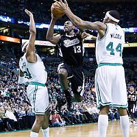 30 January 2013: Sacramento Kings point guard Tyreke Evans (13) goes for the layup past Boston Celtics power forward Chris Wilcox (44) and Boston Celtics small forward Paul Pierce (34) during the Boston Celtics 99-81 victory over the Sacramento Kings at the TD Garden, Boston, Massachusetts, USA.