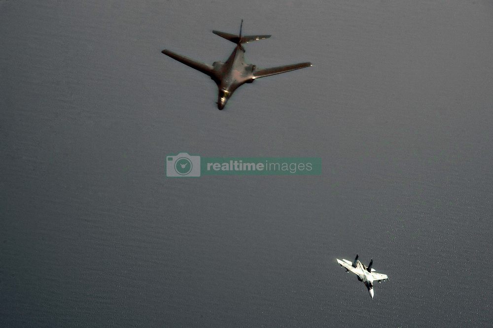 June 9, 2017 - Szczecin, Poland - A U.S. Air Force B-1B Lancer bomber, left, from the 28th Bomb Wing is intercepted by a Russian Su-27 Flanker fighter aircraft during exercise BALTOPS near Russian airspace June 9, 2017 in the Baltic Sea. Pentagon spokesman Capt. Jeff Davis said the intercept was considered ''safe and professional. (Credit Image: © Ssgt. Jonathan Snyder/Planet Pix via ZUMA Wire)