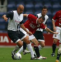 Photo: Paul Thomas.<br /> Preston North End v Manchester United. Pre Season Friendly. 29/07/2006.<br /> <br /> Danny Dichio of Preston (L) gets away from Phil Bardsley.