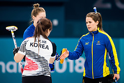 February 19, 2018 - Pyeongchang, SOUTH KOREA - 180219 Kim Seon-yeong of South Korea and Anna Hasselborg of Sweden after the Women's Curling Round Robin between Sweden and South Korea during day ten of the 2018 Winter Olympics on February 19, 2018 in Pyeongchang..Photo: Jon Olav Nesvold / BILDBYRN / kod JE / 160182 (Credit Image: © Jon Olav Nesvold/Bildbyran via ZUMA Press)