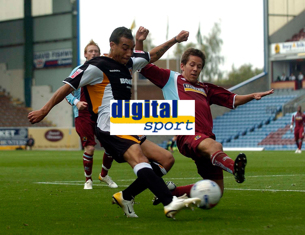 Photo: Jed Wee.<br />Burnley v Hull. Coca Cola Championship. 14/10/2006.<br /><br />Hull's Craig Fagan (L) gets a cross in as Burnley's Jon Harley tries to get the block in.