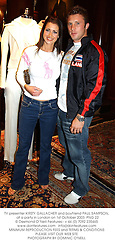 TV presenter KIRSTY GALLACHER and boyfriend PAUL SAMPSON,  at a party in London on 1st October 2003.PNG 22
