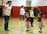 Middletown, New York - Children and adults play with hula hoops at Family Night at the Middletown YMCA on April 2, 2011.