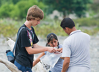 American students Eric Leatham (left) and Marianna Tucci, along with Timorese student Benny Carvalho, search for lizards in a riverbed in the Liquica district of Timor-Leste (East Timor). They are participating in an ongoing survey of Timorese reptiles and amphibians.
