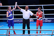 Charley-Sian Davison of Great Britain (bue) celebrates beating Carly Mcnaul of Ireland (red) in the Women's Flyweight preliminary  during The Road to Tokyo European Olympic Boxing Qualification, Sunday, March 15, 2020, in London, United Kingdom. (Mitchell Gunn-ESPA-Images/Image of Sport)