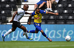 Southampton's Nathan Redmond (right) and Derby County's Andre Wisdom battle for the ball during a pre season friendly match at Pride Park, Derby.
