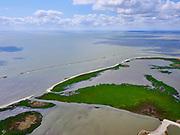 Nederland, Flevoland, Markermeer, 07-05-2021; Trintelzand, nieuw aangelegd natuurgebied gelegen tegen de westelijke zijde van de Houtribdijk. Het gebied ligt tussen tussen de vluchthaven Trintelhaven en Enkhuizen (aan de horizon). Moerasgebied voor vogels en vissen, met zandplaten, slikvelden en rietoevers. Het Trintelzand wordt gerealiseerd binnen het project Versterking Houtribdijk, en is onderdeel van het Nationaal Park Nieuw Land<br /> Trintelzand, newly constructed nature reserve next to the Houtribdijk. Marsh area for birds and fish, with sandbanks, mudflats and reed banks.<br /> luchtfoto (toeslag op standard tarieven);<br /> aerial photo (additional fee required)<br /> copyright © 2021 foto/photo Siebe Swart
