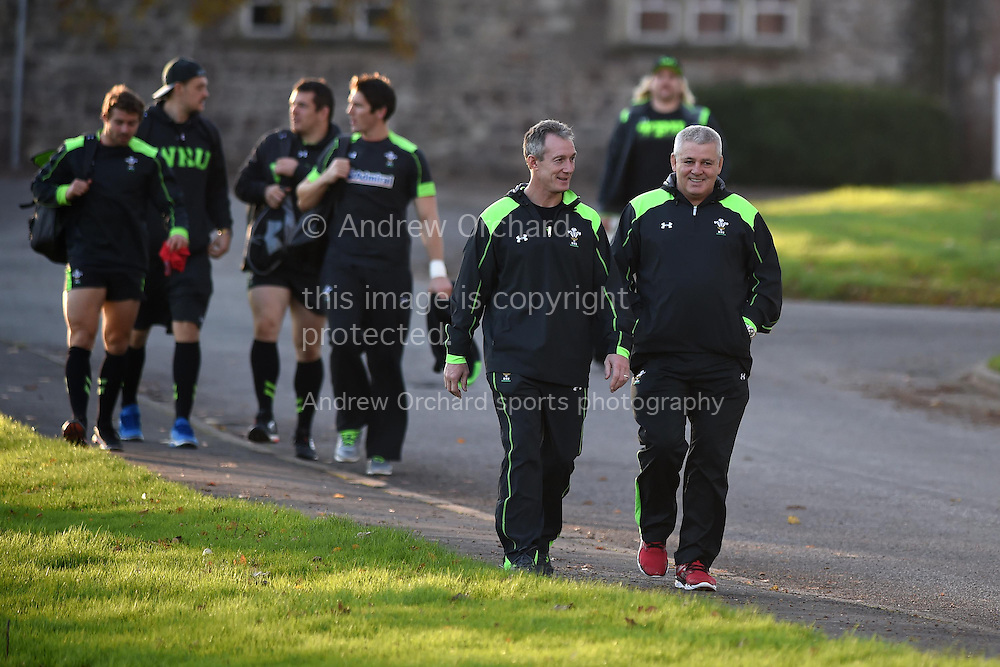 Wales coach Rob Howley and head coach Warren Gatland in relaxed mood as they walk with the players to the training field. Wales rugby team training at the Vale Resort, Hensol , near Cardiff, South Wales on Tuesday 18th November 2014. Wales are looking ahead to their next match against the Allblacks on Saturday.<br /> pic by Andrew Orchard, Andrew Orchard sports photography.
