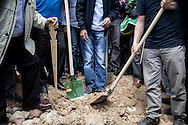 Residents of Soma in western Turkey dig graves for victims of the mining disaster, the worst in Turkeys' history, killing at least 282 people, with around 120 still missing.