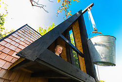 Dad of two Tom Prior has created a beautiful shingle clad, two floor play house in the garden of his Shoreham, West Sussex home for his children. A bucket on a pulley system allows Jackson, 4, to hoist supplies up into the shed. Shoreham, West Sussex, July 15 2019.