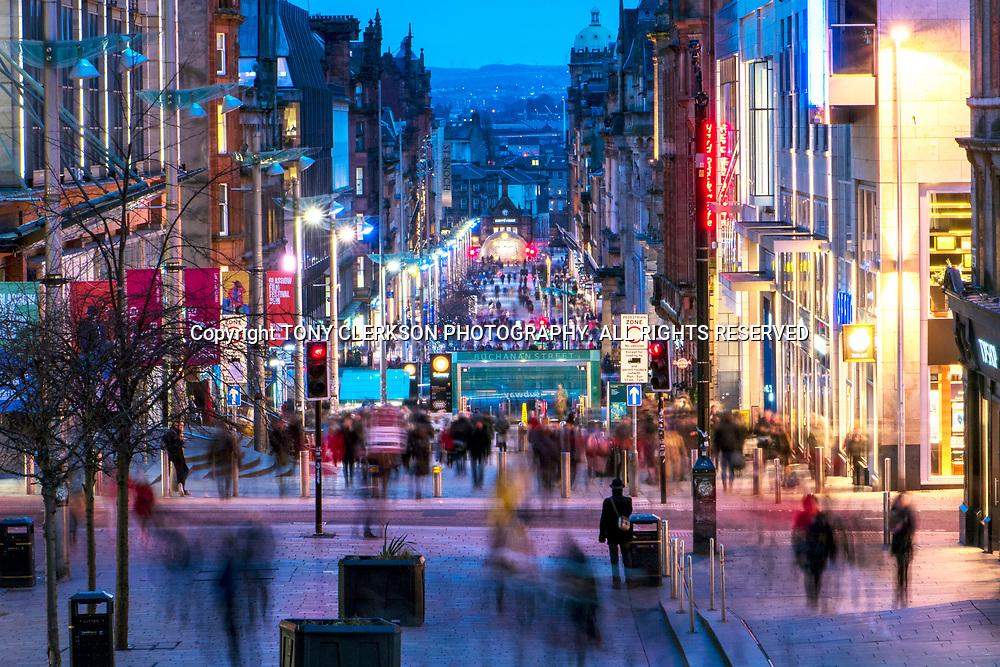 Bustling Buchanan Street in Glasgow as night falls