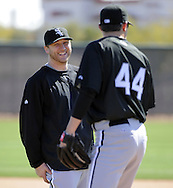 GLENDALE, AZ - FEBRUARY 23:  Mark Buehrle #56 shares a laugh with Jake Peavy #44 of the Chicago White Sox during a workout on February 23, 2010 at the White Sox training facility at Camelback Ranch in Glendale, Arizona. (Photo by Ron Vesely)