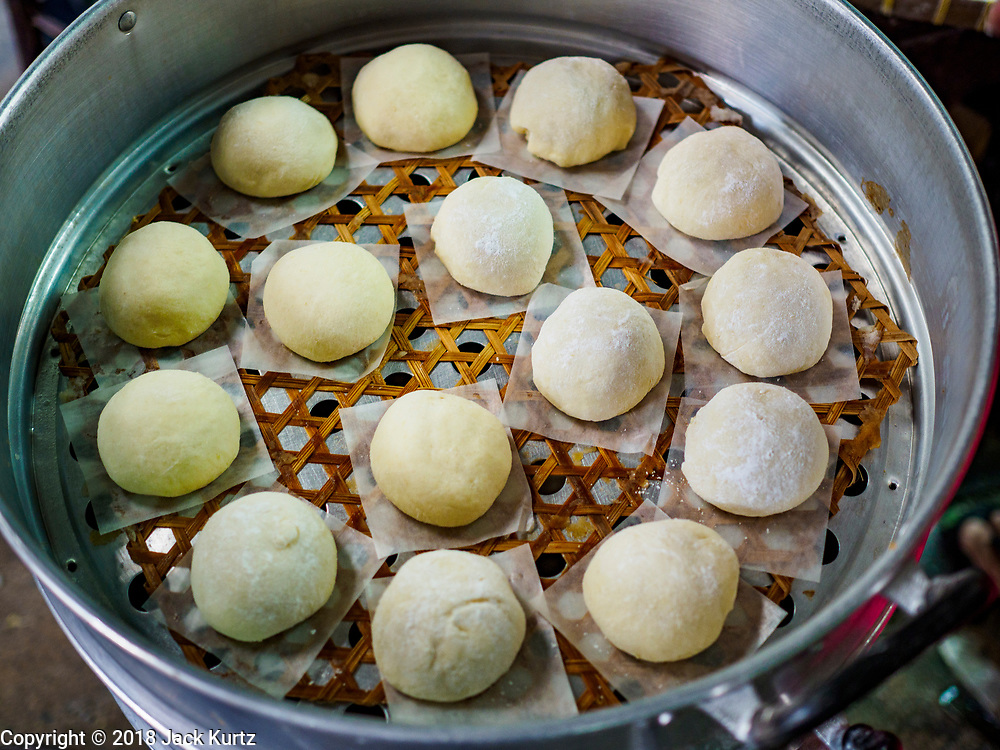 """12 FEBRUARY 2018 - BANGKOK, THAILAND: Uncooked buns in a steaming tray in a home that makes steamed Chinese buns, called """"bao"""" in the Chinatown neighborhood of Bangkok. Bao are eaten at midnight on the Lunar New Year and served to guests during New Year's entertaining. Lunar New Year, also called Tet or Chinese New Year, is 16 February this year. The coming year will be the Year of the Dog. Thailand has a large Chinese community and Lunar New Year is widely celebrated in Thailand, especially in Bangkok and large cities with significant Chinese communities.    PHOTO BY JACK KURTZ"""