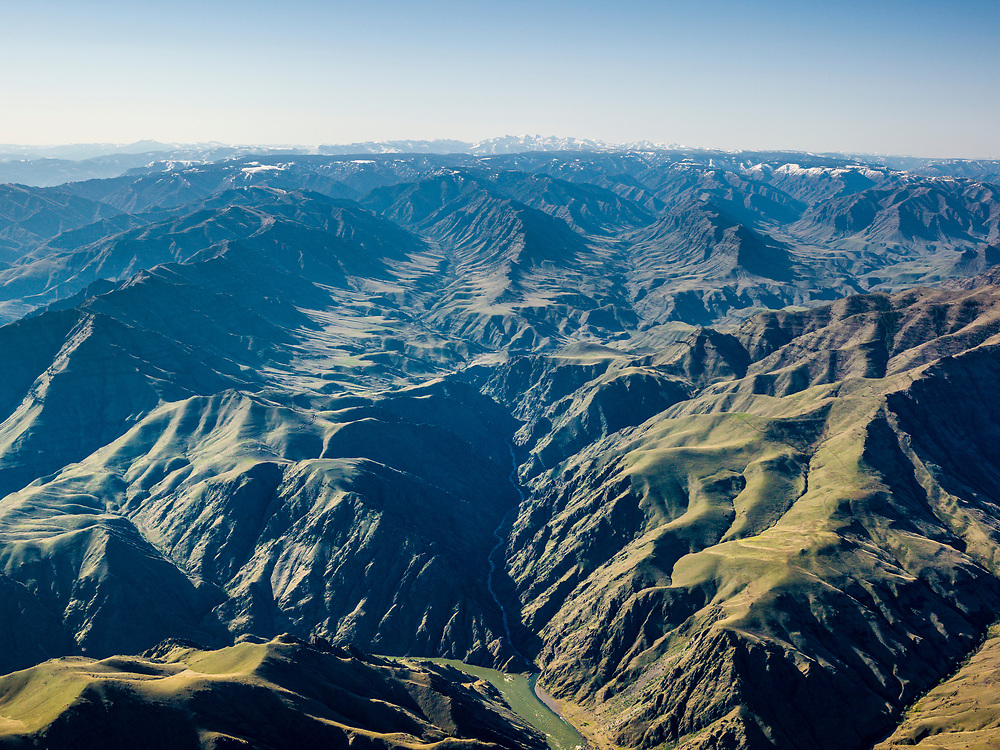 Aerial view of the Mountainous Terrain of Washington State with a glimpse of the Snake River at the bottom of frame in Hells Canyon.  Licensing and Open Edition Prints.