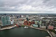 Nederland, Zuid-Holland, Rotterdam, 23-10-2013; Kop van Zuid met Rijnhaven en Wilhelminakade. Op de Wilhelminakade De Rotterdam, de verticale stad van OMA/Rem Koolhaas <br /> Verder de Toren op Zuid en het rode Nieuwe Luxor Theater. In het water het Drijvend Paviljoen, hoogbouw langs de Posthumalaan en Laan op Zuid. In de achtergrond de Nieuwe Maas en het Noordereiland. Skyline van de binnenstad.<br /> <br /> <br /> luchtfoto (toeslag op standard tarieven);<br /> aerial photo (additional fee required);<br /> copyright foto/photo Siebe Swart