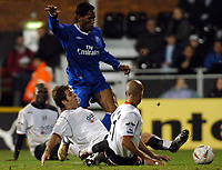 Photo: Javier Garcia/Digitalsport<br /> 30/11/2004 Fulham v Chelsea, Carling Cup Quarter Final, Craven Cottage<br /> Three Fulham players l-r Papa Bouba Diop, Carlos Bocanegra and Zesh Rehman are grounded as Didier Drogba gets a shot in