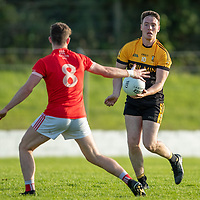 Coolmeen's Maccon Byrne hand passes the ball away from Eire Og's Darren O'Brien