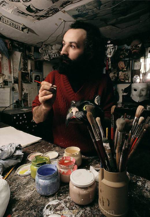 Guerrino Lovato, mask maker, in his studio in Venice, Italy during Winter Carnival.