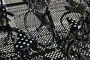 parked bicycles with grating shadow projection
