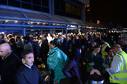 Poeple outside London City Airport which has been closed as dozens of passengers were treated for breathing difficulties after a suspected chemical incident at the airport.