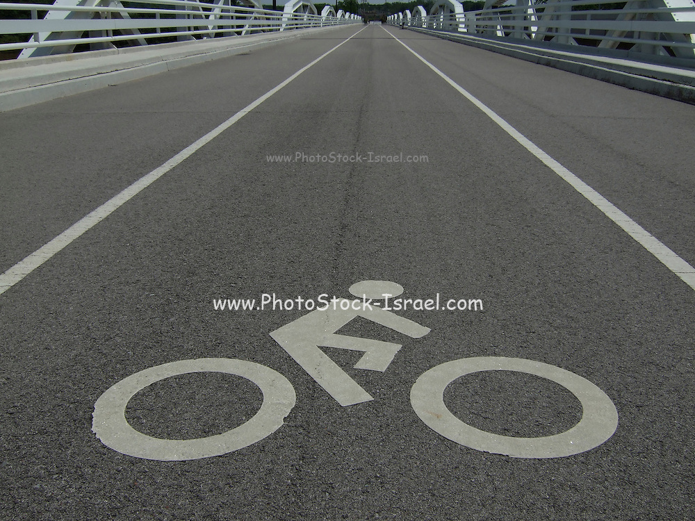 Bicycle lane with an abstract graphic sign of a bicycle with rider.