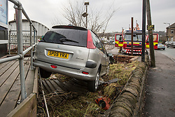 © Licensed to London News Pictures. 28/12/2015. Baildon UK. Flooding in baildon has left a car dealership destroyed after the River Aire broke it's banks and smashed cars into one another & into buildings.Photo credit: Andrew McCaren/LNP