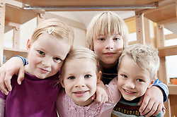 Group picture of four little child in kindergarten