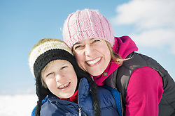 Portrait of mother and son, smiling, close up, Bavaria, Germany