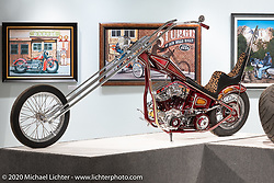 """Josh Soto's Nostalgia, a chopped 1950 Harley-Davidson Panhead with its mid-70s 30"""" over narrowed Denver springer, in the Heavy Mettle - Motorcycles and Art with Moxie exhibition at the Sturgis Buffalo Chip. This is the 2020 iteration of the annual Motorcycles as Art series curated and produced by Michael Lichter. Sturgis, SD, USA. Friday, August 7, 2020. Photography ©2020 Michael Lichter."""