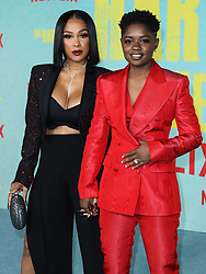 Chris Amore and actress/rapper Bre-Z (Calesha Murray) arrive at the Los Angeles Premiere Of Netflix's 'The Harder They Fall' held at the Shrine Auditorium and Expo Hall on October 13, 2021 in Los Angeles, California, United States. Photo by Xavier Collin/Image Press Agency/ABACAPRESS.COM