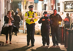 © Licensed to London News Pictures. 25/09/2020. London, UK. Police patrol along Portobello Road in Notting Hill, west London before before a 10pm curfew comes in to place as part of new restrictions intended to prevent the spread of COVID-19. Photo credit: Ben Cawthra/LNP
