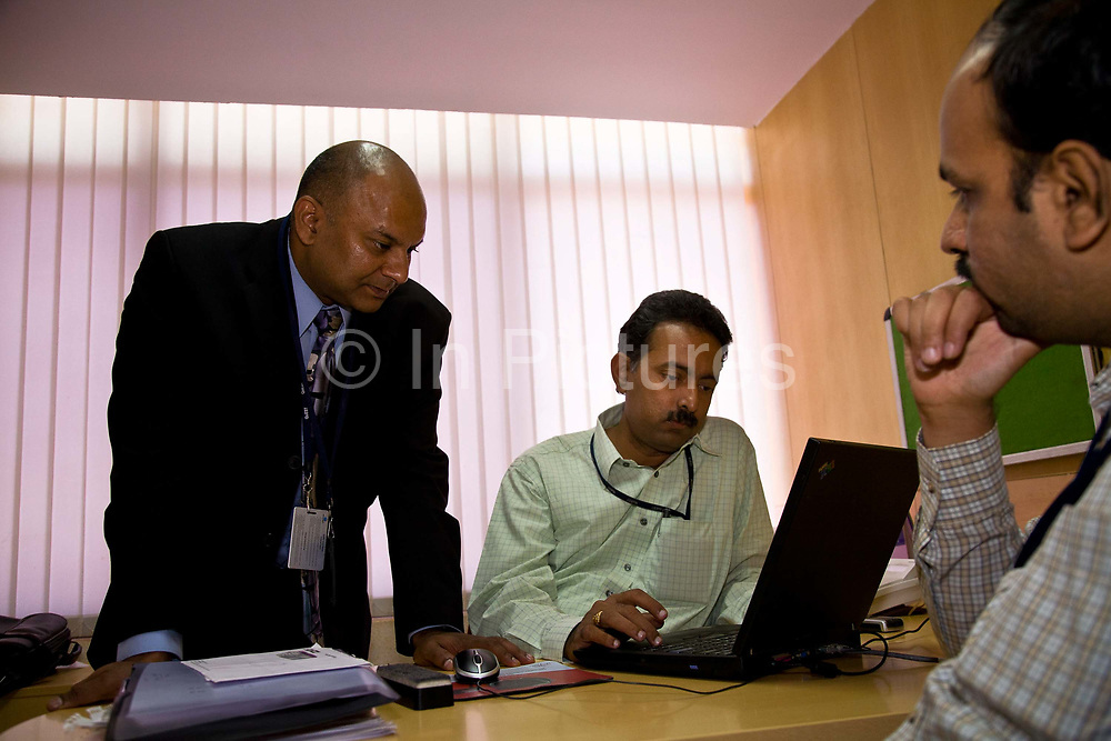 Bejoy Geoorge in an IT meeting with colleagues at Bangalore office, India.