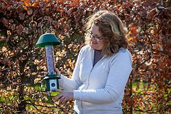 Feeding the birds with a squirrel proof bird feeder