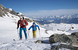 Ski mountaineers climbing on snowy mountain, Zell am See, Austria