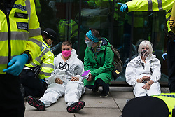 Metropolitan Police officers arrest climate activists from Extinction Rebellion who had occupied the street outside the Department of Transport in protest against roadbuilding on 3 September 2020 in London, United Kingdom. Extinction Rebellion activists are attending a series of September Rebellion protests around the UK to call on politicians to back the Climate and Ecological Emergency Bill (CEE Bill) which requires, among other measures, a serious plan to deal with the UK's share of emissions and to halt critical rises in global temperatures and for ordinary people to be involved in future environmental planning by means of a Citizens' Assembly.