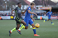 AFC Wimbledon striker Lyle Taylor (33) battles for possession with Bristol Rovers defender Marc Bola (20) during the EFL Sky Bet League 1 match between AFC Wimbledon and Bristol Rovers at the Cherry Red Records Stadium, Kingston, England on 17 February 2018. Picture by Matthew Redman.