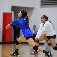 Laguna Acoma Hawks Rian Kie (2) and Angel Day (8) lunge after a serve from the Grants Pirates Tuesday at Grants High School.