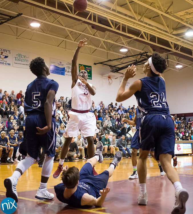 JM Robinson's Daniel Spencer (3) hits a basket while being covered by the Hickory Ridge defense during a 3A west state basketball playoff game Thursday, February 25, 2016 at Jay M Robinson High School in Concord, NC. Photo by JASON E. MICZEK - www.miczekphoto.com
