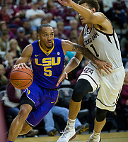 LSU guard Daryl Edwards (5) drives the baseline against Texas A&M forward DJ Hogg (1) during the second half of an NCAA college basketball game Saturday, Jan. 6, 2018, in College Station, Texas. (AP Photo/Sam Craft)