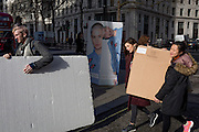 "The crew of a fashion house carry boards and equipment outisde London Fashion Week in the Strand, on 17th Febriary 2017, in London, England, United Kingdom. London Fashion Week is a clothing trade show held in London twice each year, in February and September. It is one of the ""Big Four"" fashion weeks, along with the New York, Milan and Paris. The fashion sector plays a significant role in the UK economy with London Fashion Week alone estimated to rake in £269 million each season. The six-day industry event allows designers to show their collections to buyers, journalists and celebrities and also maintains the city's status as a top fashion capital. (Photo by Richard Baker / In Pictures via Getty Images)"