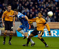 Photo: Ed Godden/Sportsbeat Images.<br />Wolverhampton Wanderers v Oldham Athletic. The FA Cup. 06/01/2007. Wolves' Karl Henry (R), tackles Gary McDonald from behind.