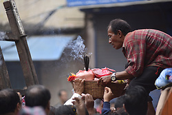 April 27, 2018 - Kathmandu, NP, Nepal - Nepalese people offering rituals during a Rato Machindranath festival celebrated at Lagankhel, Laltipur, Nepal on Friday, April 27, 2018. Rato Machindranath is also said as the 'god of rain' and both Hindus and Buddhists worship the Machindranath in hope of good rain to prevent drought during the rice plantation season. According to old belief, whoever catches the thrown holy coconut fruit, it will be blessed with a baby son and will have a prosper life year ahead. (Credit Image: © Narayan Maharjan/NurPhoto via ZUMA Press)